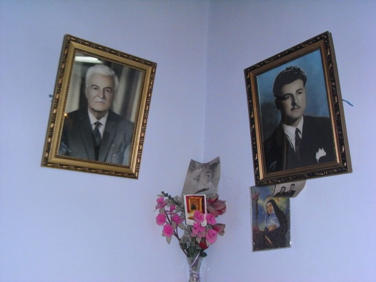 Two framed photographs of the same man, younger and older.