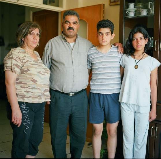 Portrait of husband, wife, son and daughter, Ma'loula, Syria August 2008